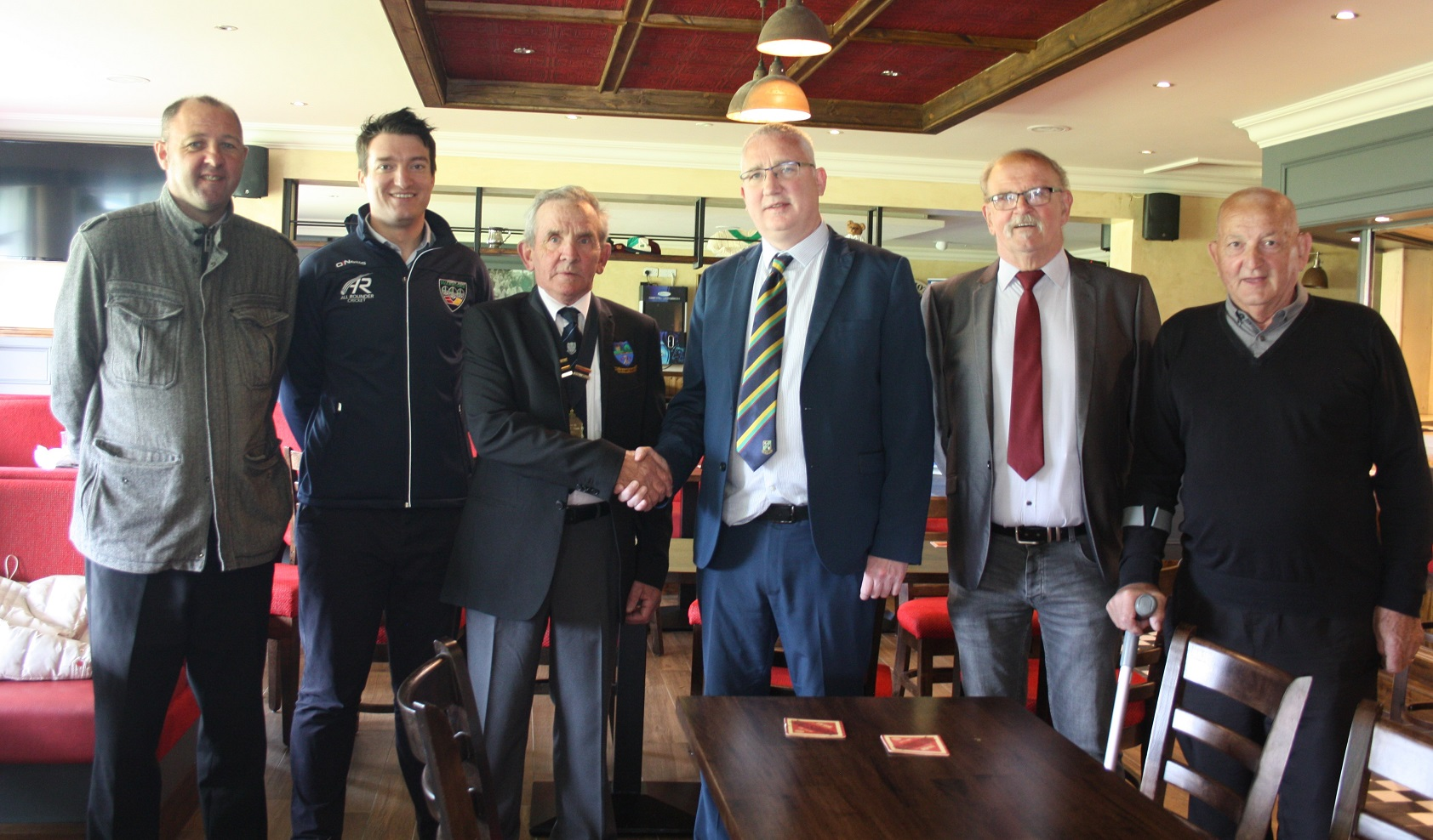 NW Chairman Brian Dougherty and General Manager Peter McCartney congratulates Glendermott President Alan Dougherty and committee members on the official opening of their refurbished clubhouse