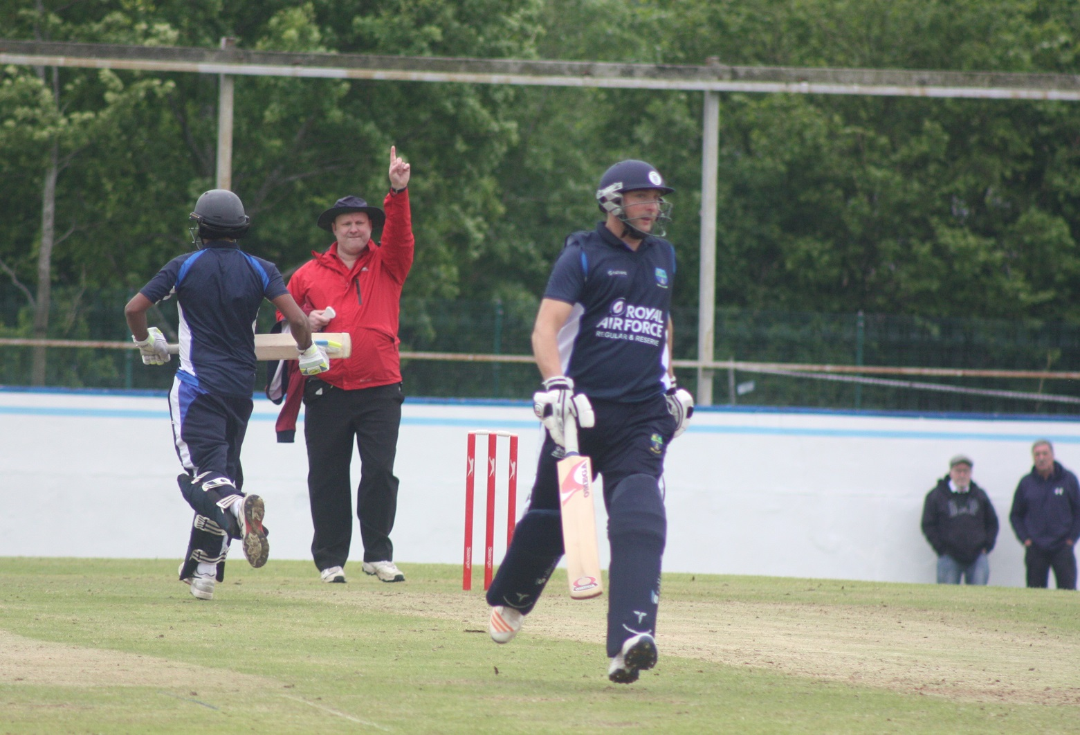 Umpire Matt Alott signals the end of Keshan Wijerathne's innings